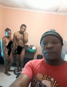 SHOCKER!! Man Catches His Wife Sleeping With Another Man; Takes A Selfie With Them (See Photos)